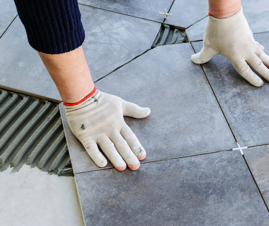 Slate grey ceramic tile being installed in a home by a flooring expert